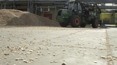Wood chipper passing by before the camera Stock Footage