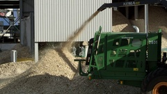 Wood processing factory, woodchipper making sawdust Stock Footage
