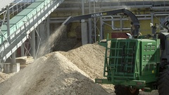 Woodchipper making wood chips and sawdust Stock Footage