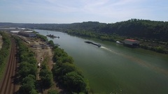 Aerial shot of a barge on the Ohio River in Beaver County Stock Footage