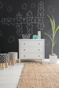 White dresser and upholstered stools Stock Photos