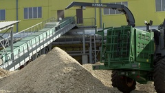 Pile of wood chips made by wood chipper Stock Footage