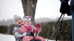Active Happy Children Sledding and Enjoying Winter Snowy Day in Slow Motion Stock Footage
