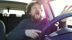 Man driving car saying I love you looking camera slow motion Stock Footage