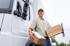 Delivery Boy Standing Next To A Truck Stock Photos