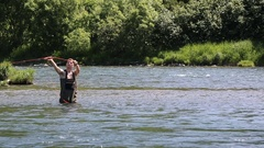 Fisherman fly fishing in cold water in mountain river Stock Footage