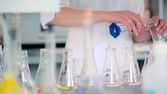 The liquid pour into a conical flask. Stock Footage