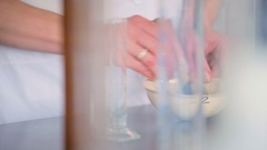 Laboratory worker mixing medications in a bowl. Stock Footage