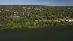 Fly by shot of Beaver, Pennsylvania featuring River Road in Western Pennsylvania Stock Footage