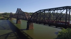 Aerial of train crossing a bridge over the Ohio River in Beaver County Stock Footage