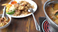 Thai hot spicy soup with prawn boiled in pot Stock Footage