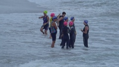 Triathletes get ready to compete in a triathlon. Stock Footage