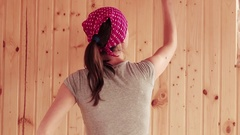 Young woman painting the wooden wall Stock Footage