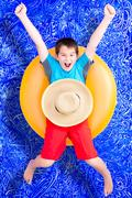 Cheerful little boy celebrating his summer holiday Stock Photos