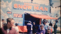 Crowds attend a traveling carnival in country town, 3912 vintage film home movie Stock Footage