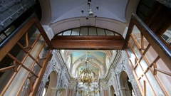 Walk through the magnificent white church decorated with white figures and Stock Footage