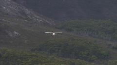 Plane lands in the Tasman wilderness Stock Footage