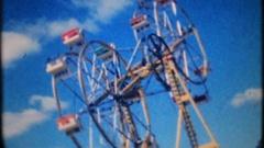 Crowds enjoy rides at local amusement park, 3913 vintage film home movie Stock Footage