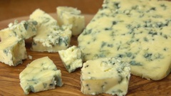 Cubes of blue Roquefort cheese Stock Footage