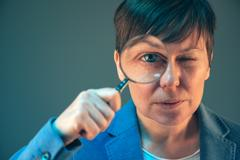 Female tax inspector with magnifying glass Stock Photos