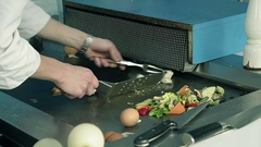 Close Up of Chef in the Kitchen Cooked Meat Dish with Vegetables in Restaurant Stock Footage