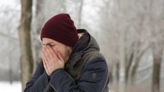 Man coughing winter outdoors Stock Footage