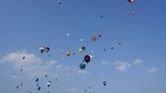Many hot air balloons flying in blue sky Stock Footage