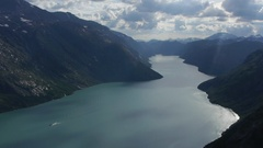 Fixed shot of boat in Besseggen, fjord in Norway Stock Footage