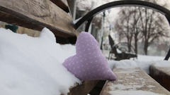 Valentines day or Love winter idea. Vintage Bench with heart in winter park Stock Footage