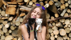 Beautiful girl holds in hands two little kittens Stock Footage