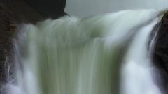 Wispy water falls between huge rocks - HD Stock Video Stock Footage