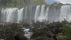 Tad Lo waterfall, wide view with rocks,Tad Lo,Bolaven,Laos Stock Footage