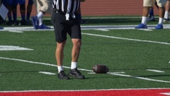A referee and men playing American football, slow motion. Stock Footage
