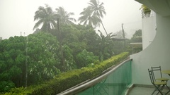 Tropical downpour. View from the resort apartment balcony Stock Footage