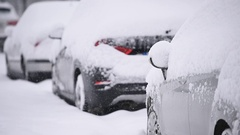 Snow covered cars are seen during a heavy snowfall in the city Stock Footage