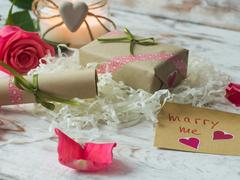 Will you marry me words written on paper, love card. Valentine's Day postcard. Stock Photos