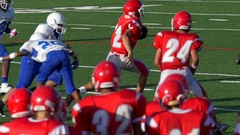 A player scores a touchdown while playing American football, slow motion. Stock Footage