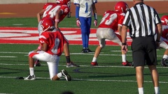 A kicker gets ready to kick off while playing American football, slow motion. Stock Footage