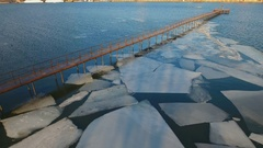 Frozen old pier at river side in winter time. Stock Footage
