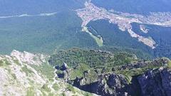 Caraiman Peak, aerial tilt to Bucegi city, Romania Stock Footage