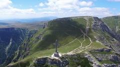 Heroes Cross on Caraiman Mountains, aerial view, Romania Stock Footage