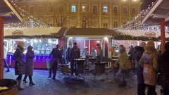 The Christmas market with a crowds of tourists next to the food stalls Stock Footage