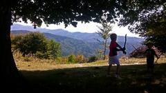 Kids playing, mountain range Stock Footage