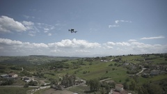 Recording a dji inspire drone while flying at italian landscape Stock Footage