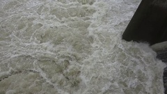 CALIFORNIA rain, looking down into raging white water tilt up Stock Footage