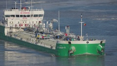 A tanker ship float between ice floes on the Danube near Tulcea Stock Footage