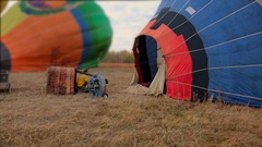 Air balloon being inflated with propane gas burner before flight Stock Footage