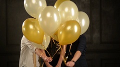 Excited Surprised Women Hiding among Balloons Having Fun during a Party. Closeup Stock Footage