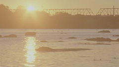 Sunrise over River and City Stock Footage