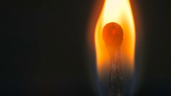 Wooden match burning Stock Footage